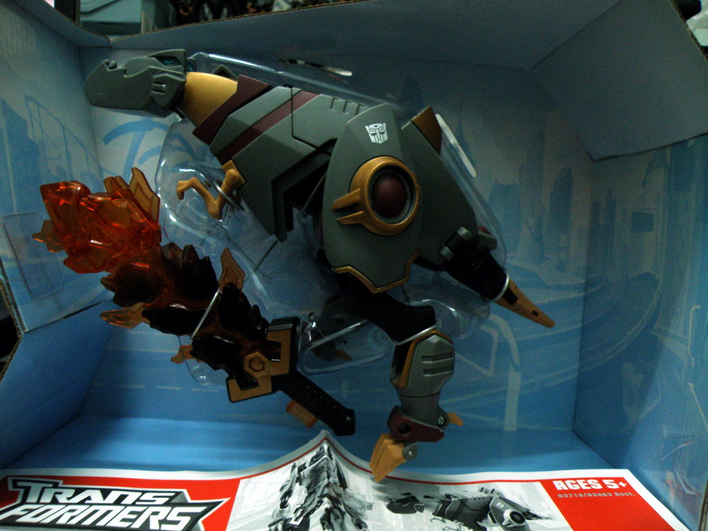 Grimlock comes with an oversized sword and a transformation manual