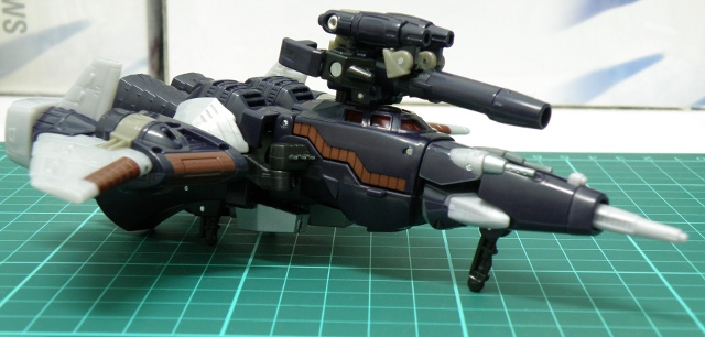 Cyclonus cybertronian jet with gun attached.