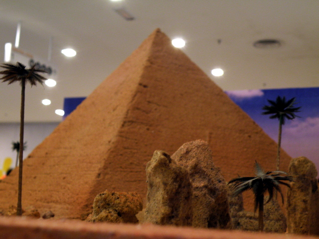 Close up shot of structures surrounding pyramid.