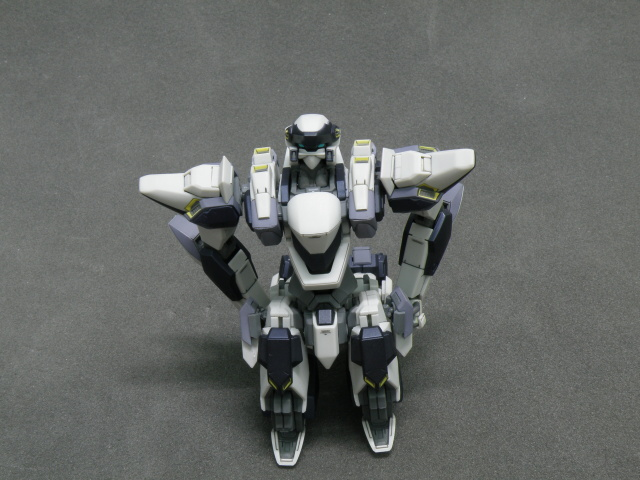 ARX-7 on bended knees with arm at the back.