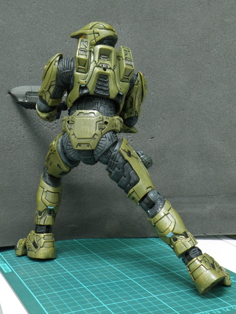 MasterChief taking aim with assault rifle back view.