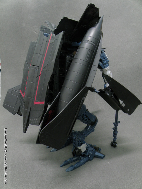Default Leader Class JetFire back without removal of parts.