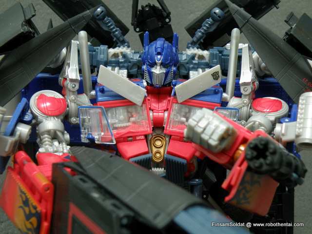 Notice JetFire head is sticking up like a sore thumb behind Optimus Prime head.