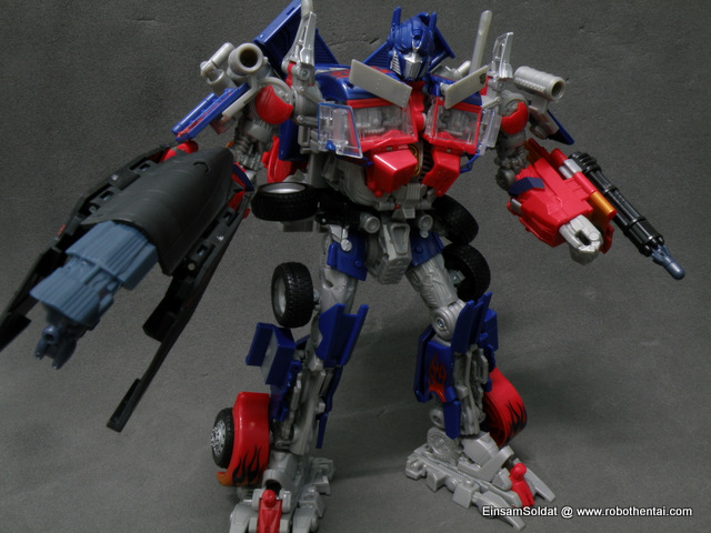 Step 1 - Attach Gatling Gun and transformed blaster to Optimus Prime.